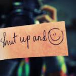 Diam dan senyum.